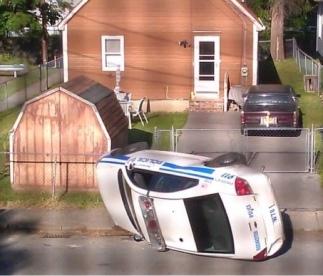 police car flipped